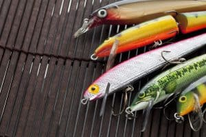 fishing lures jerkbaits on wooden mat colors