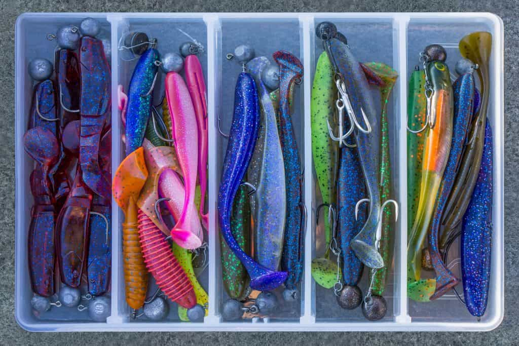 Soft plastics in tackle box with jig heads colors