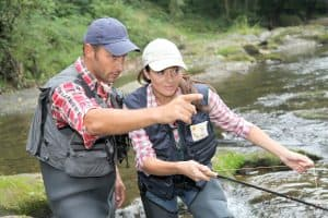 guide fly fishing pointing woman female river