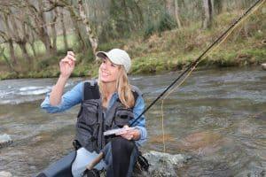 woman fishing to illustrate fishing license article Walmart