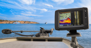 Best fish finder under 300 image of boat in sunny weather with trolling motor and fish finder