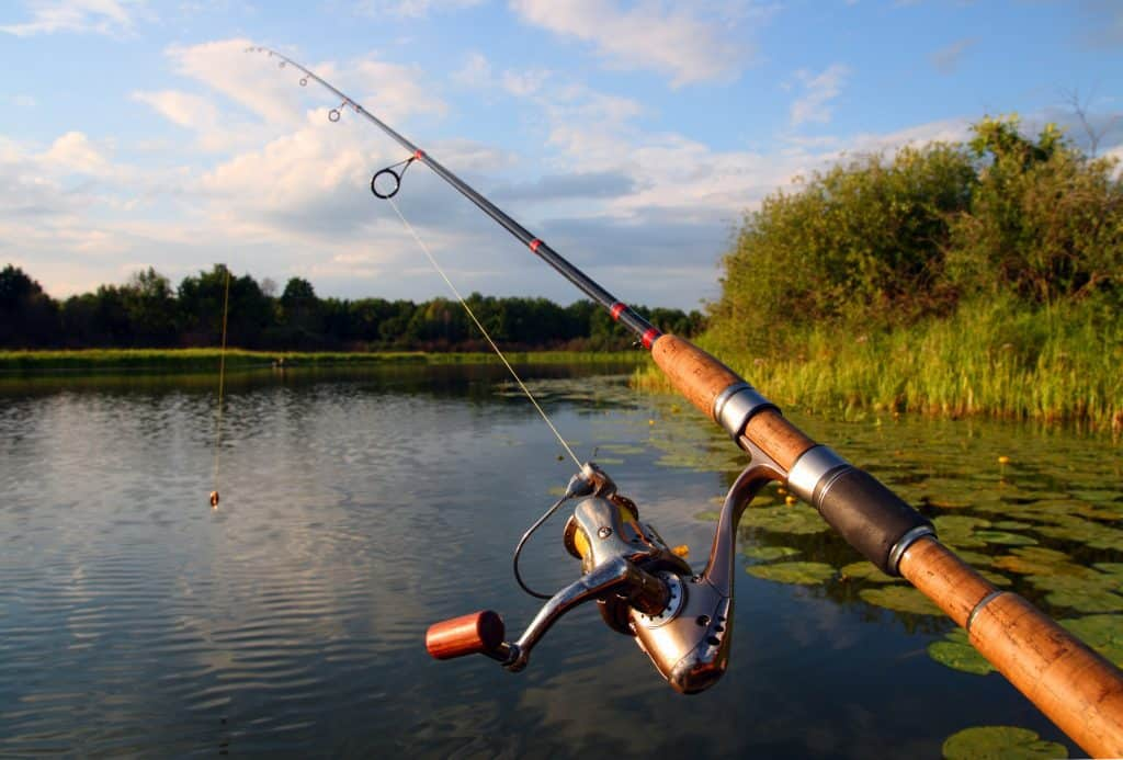 best fall bass fishing lures picture of a fishing rod by a lake