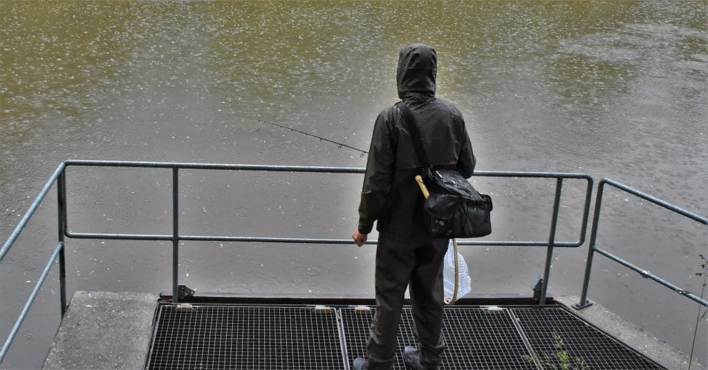 storm picture of fisherman in the rain