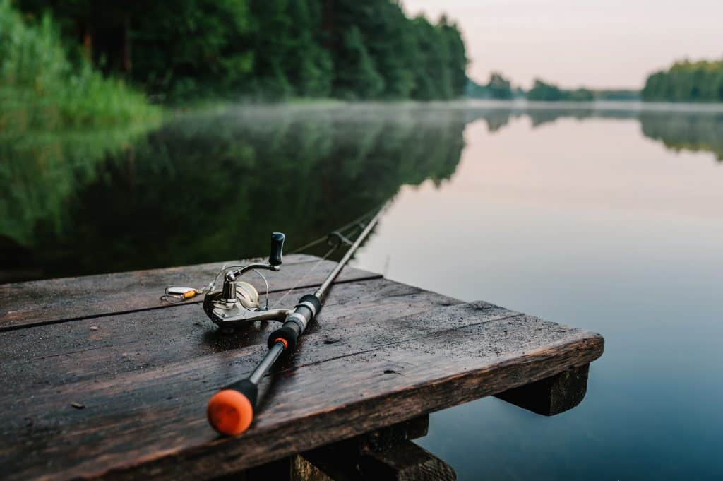 best ultralight spinning combo image of a rod and reel with a spinner lying on a dock