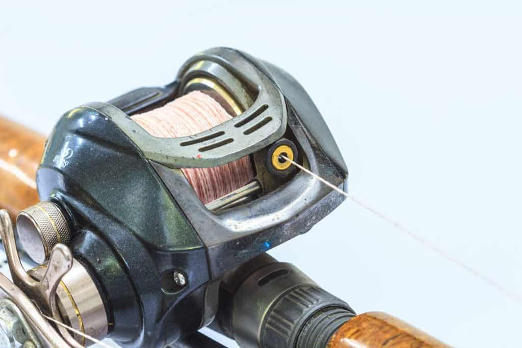 Close up image of a baitcasting reel spooled with braid