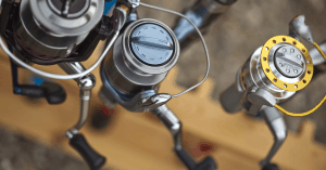 Close up shot of three spinning reels spinning reel sizes feature image