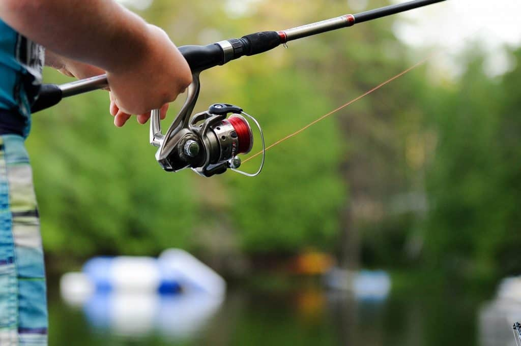 Man with a spinning rod and reel combo
