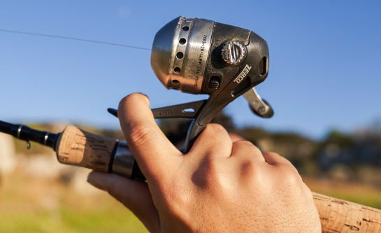fishing reel types image of a spincast reel