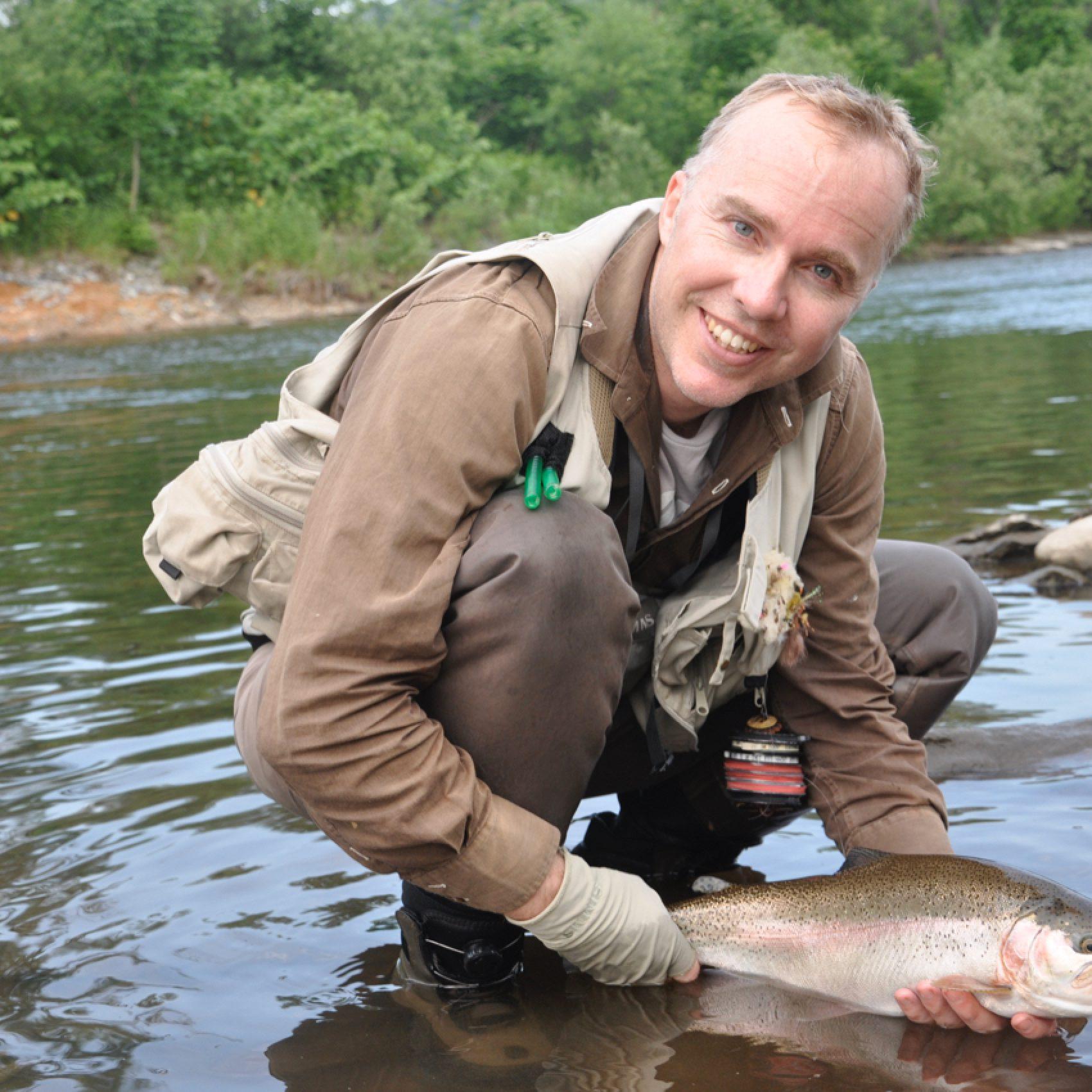 Rick Wallace with a fat rainbown trout taken in Hokkaido's Teshio River. Credit: Takahiko Chiba
