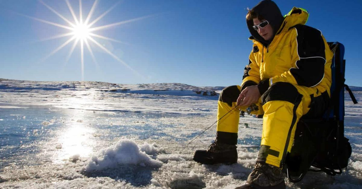 Fisherman enjoying a day on the ice on a bright sunny day