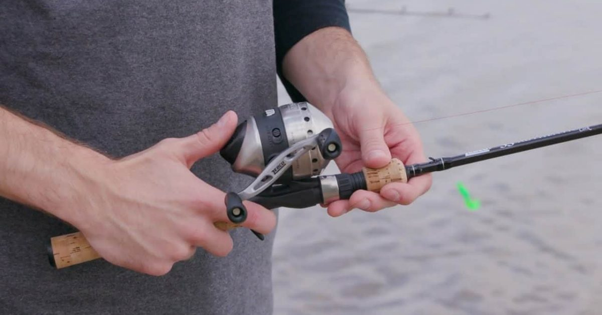 Spincast reels and rod man holding